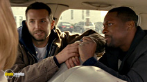 A still #15 from Silver Linings Playbook with Bradley Cooper and Chris Tucker