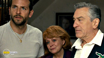 A still #18 from Silver Linings Playbook with Robert De Niro, Bradley Cooper and Jacki Weaver