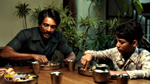 A still #13 from Life of Pi with Adil Hussain and Ayush Tandon