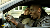 A still #9 from Untouchable with François Cluzet and Omar Sy