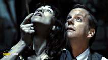 A still #23 from Melancholia (2011) with Kiefer Sutherland and Charlotte Gainsbourg