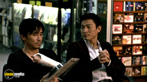 A still #13 from Infernal Affairs 1 with Andy Lau and Tony Chiu Wai Leung