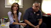 A still #16 from Modern Family: Series 2 with Julie Bowen and Vic Polizos