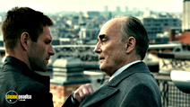 A still #3 from The Expatriate (2012) with Aaron Eckhart and Garrick Hagon