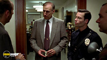 A still #4 from L.A. Confidential with James Cromwell and Guy Pearce