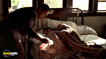 A still #11 from L.A. Confidential with Russell Crowe and Marisol Padilla Sánchez