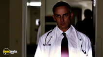 A still #18 from Transcendence with Wallace Langham