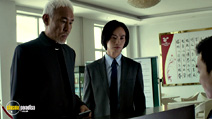 A still #13 from Man of Tai Chi with Tiger Hu Chen