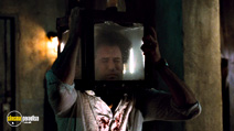 A still #14 from Saw 5 with Scott Patterson