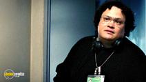 A still #14 from The Interpreter with Adrian Martinez