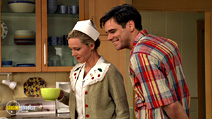 A still #15 from The Truman Show with Jim Carrey and Laura Linney