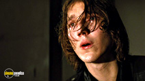 A still #19 from Looper with Paul Dano
