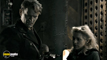 A still #20 from Iron Sky with Götz Otto and Julia Dietze