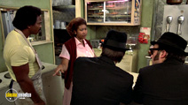 A still #16 from The Blues Brothers with Aretha Franklin