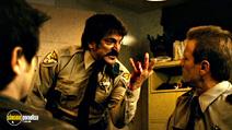 A still #13 from Planet Terror with Tom Savini and Carlos Gallardo
