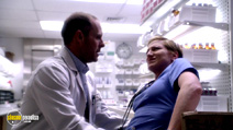 A still #38 from Nurse Jackie: Series 1 with Edie Falco and Paul Schulze