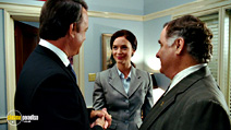 A still #25 from Charlie Wilson's War with Tom Hanks, Peter Gerety and Emily Blunt