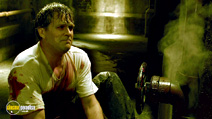 A still #30 from Saw 7 with Cary Elwes