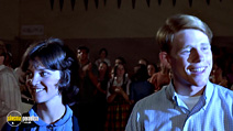 A still #13 from American Graffiti with Ron Howard and Cindy Williams