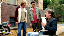 A still #50 from Dumb and Dumber To with Jeff Daniels, Jim Carrey and Brady Bluhm