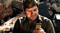 A still #38 from Kelly's Heroes with George Savalas