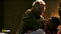 A still #18 from The Skeleton Key with Gena Rowlands and John Hurt