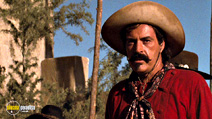 A still #22 from Tombstone with Powers Boothe