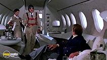 A still #48 from James Bond: Moonraker with Roger Moore and Leila Shenna