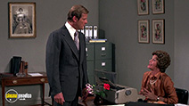A still #47 from James Bond: Moonraker with Roger Moore and Lois Maxwell
