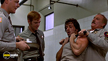 A still #26 from Rambo: First Blood with Sylvester Stallone, Jack Starrett, David Caruso and Chris Mulkey