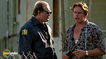 A still #14 from Point Break with Gary Busey