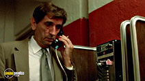 A still #19 from Wild at Heart with Harry Dean Stanton