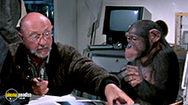 A still #7 from Phenomena (1985) with Donald Pleasence