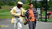 A still #5 from Happy Gilmore with Carl Weathers and Adam Sandler