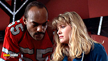 A still #5 from From Beyond (1986) with Barbara Crampton and Ken Foree