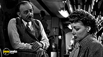 A still #3 from Woman on the Run (1950) with John Qualen and Ann Sheridan