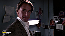 A still #9 from 52 Pick-Up (1986) with Roy Scheider