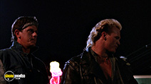 A still #9 from Stone Cold (1991) with Sam McMurray and Brian Bosworth