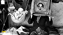 A still #8 from The Kid (1921) with Charles Chaplin