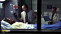 A still #5 from Gang Related (1997) with David Paymer and Dennis Quaid